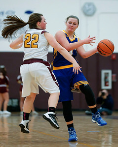 Megan Madsen (4) of Johnsburg passes the ball around Brooke Legnaioli (22) of Richmond-Burton during the fourth quarter of their game at Richmond-Burton High School  on Tuesday, December 6, 2016 in Richmond. The Skyhawks defeated the Rockets 40-24. John Konstantaras photo for the Northwest Herald