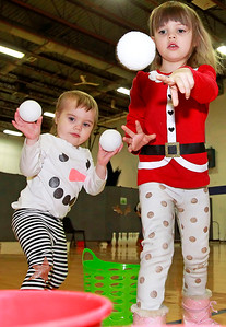 Candace H. Johnson-For Shaw Media Starlet Paulus, 2, of Grayslake and her sister, Lulu, 4, play the Snowball Buckets game during the Milk-N-Cookies with Santa event at the Round Lake Area Park District in Round Lake.