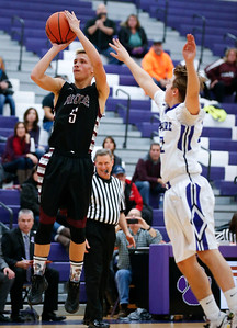 Trevor Potter (5) of Prairie Ridge puts up a shot as Nathan Cork (32) of Hampshire defends during the second quarter of their game at Hampshire High School on Wednesday, December 7, 2016 in Hampshire. The Wolves defeated the Whip-Purs 55-38. John Konstantaras photo for the Northwest Herald