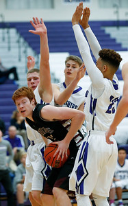 Matthew Hoyland (12) of Prairie Ridge faces a wall of Hampshire defenders under the basket during the second quarter of their game at Hampshire High School on Wednesday, December 7, 2016 in Hampshire. The Wolves defeated the Whip-Purs 55-38. John Konstantaras photo for the Northwest Herald