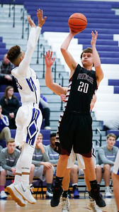 Kyle Loeding (20) of Prairie Ridge puts up a shot over Frederick Powell (23) of Hampshire during the first quarter of their game at Hampshire High School on Wednesday, December 7, 2016 in Hampshire. The Wolves defeated the Whip-Purs 55-38. John Konstantaras photo for the Northwest Herald