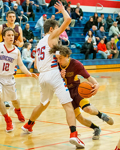 Richmond-Burton's Blaine Bayer (0) draws a blocking call from Marion Central Catholic defender Thomas Menner (25) Tuesday, Dec. 13 2016 at Marion Central High School in Woodstock. Marion went on to win 60-35. KKoontz-For Shaw Media