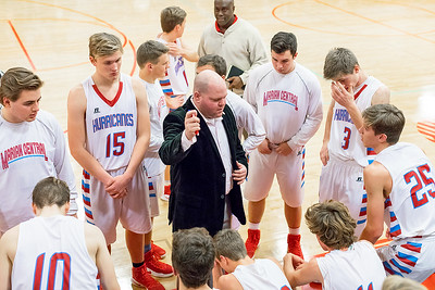 Marion Central Catholic's head coach Jim Sarther talks to his team during a timeout Tuesday, Dec. 13 2016 at Marion Central High School in Woodstock. Marion went on to win 60-35. KKoontz-For Shaw Media