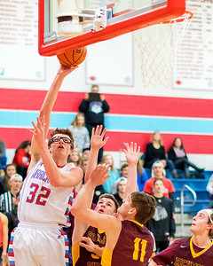 Marion Central Catholic's Sam Ohlrich (32) goes over the Richmond Burton defense for the basket Tuesday, Dec. 13 2016 at Marion Central High School in Woodstock. Marion went on to win 60-35. KKoontz-For Shaw Media