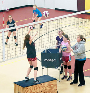 Candace H. Johnson-For Shaw Media Girls from the McHenry County Juniors Volleyball Club practice at the Volo Sportsplex in Volo.