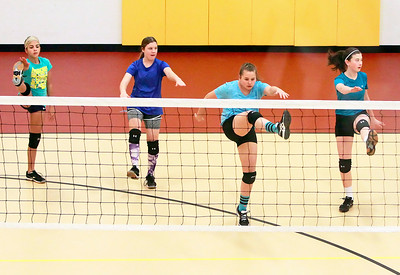 Candace H. Johnson-For Shaw Media Girls from the McHenry County Juniors Volleyball Club warm up before practice at the Volo Sportsplex in Volo.