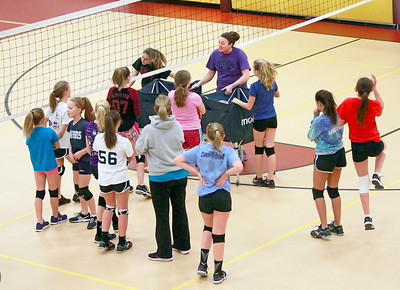 Candace H. Johnson-For Shaw Media Girls from the McHenry County Juniors Volleyball Club come together during practice at the Volo Sportsplex in Volo.