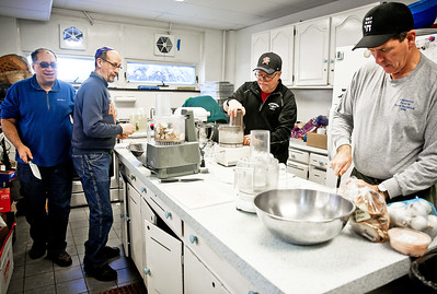 Michelle LaVigne/ For Shaw Media Left to right, Mark Goldberg of Crystal Lake, Larry Sternberg of Algonquin, Dale Morton of Woodstock and Craig Krandel of Woodstock start to work on making latkes in the basement of the McHenry County Jewish Congregation in Crystal Lake on Sunday, December 18, 2016 for the McHenry County Jewish Congregation's Community Chanukah Celebration.