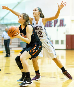 Crystal Lake Central forward Kathleen Penza (14) eyes the basket after the rebound against Prairie Ridge Monday Dec. 19, 2016 at Prairie Ridge High School in Crystal Lake. Prairie Ridge went on to win 43-34.  KKoontz – For Shaw Media