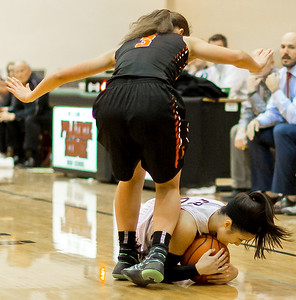 Prairie Ridge Lauren Brown (Right) dives for a loose ball in front of Crystal Lake Central defender Corrine Hamill Monday Dec. 19, 2016 at Prairie Ridge High School in Crystal Lake. Prairie Ridge went on to win 43-34.  KKoontz – For Shaw Media