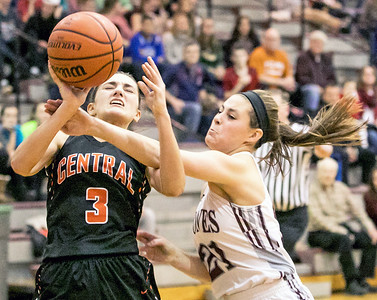 Crystal Lake Central's Corrine Hamill (3) draws a foul from Prairie Ridge defender Emily Perhats (21) Monday Dec. 19, 2016 at Prairie Ridge High School in Crystal Lake. Prairie Ridge went on to win 43-34.  KKoontz – For Shaw Media