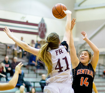 Prairie Ridge's Sammi Lockwood (41) blocks the shot taken by Crystal Lake Central's forward Kathleen Penza Monday Dec. 19, 2016 at Prairie Ridge High School in Crystal Lake. Prairie Ridge went on to win 43-34.  KKoontz – For Shaw Media