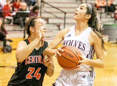 Prairie Ridge's Nicole Dom (15) drives toward the baseline past Crystal Lake Central defender Madison Haslow (24) Monday Dec. 19, 2016 at Prairie Ridge High School in Crystal Lake. Prairie Ridge went on to win 43-34.  KKoontz – For Shaw Media