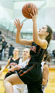 Crystal Lake Central's Corrine Hamill drives in for the lay-up basket Monday Dec. 19, 2016 at Prairie Ridge High School in Crystal Lake. Prairie Ridge went on to win 43-34.  KKoontz – For Shaw Media