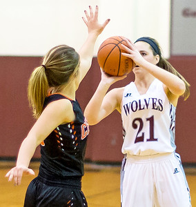 Prairie Ridge's Emily Perhats (21) shoots a 3-point shot in the third quarter Monday Dec. 19, 2016 at Prairie Ridge High School in Crystal Lake. Perhats finished with 11 points in the 43-34 victory over Crystal Lake Central. KKoontz – For Shaw Media