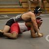 Kaneland's Riley Vanik wrestles Marist's Ben Jackson in the 182 lb class on Dec. 17 at the Kaneland Wrestle Quad.