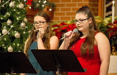 Mike Greene - For Shaw Media  Molly Schneeweiss, left, 13 of Crystal Lake, performs a duet with Meghan Schneeweiss, 15 of Crystal Lake, during St. Paul's United Church of Christ's annual Christmas Eve Candlelight Worship Services Saturday, December 24, 2016 in Crystal Lake. The 5 p.m. Family Worship Service included performances by the Connection Youth Choir with the Adult Choir performing during the traditional 11 p.m. worship service.