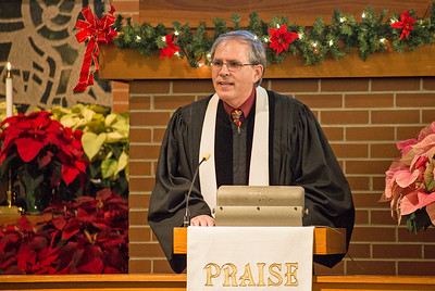Mike Greene - For Shaw Media  Pastor Greg Lucas speaks during St. Paul's United Church of Christ's annual Christmas Eve Candlelight Worship Services Saturday, December 24, 2016 in Crystal Lake. The 5 p.m. Family Worship Service included performances by the Connection Youth Choir with the Adult Choir performing during the traditional 11 p.m. worship service.