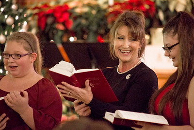 Mike Greene - For Shaw Media  Ginny Deurling, center of Woodstock, smiles while directing  the Connection Youth Choir during St. Paul's United Church of Christ's annual Christmas Eve Candlelight Worship Services Saturday, December 24, 2016 in Crystal Lake. The 5 p.m. Family Worship Service included performances by the Connection Youth Choir with the Adult Choir performing during the traditional 11 p.m. worship service.