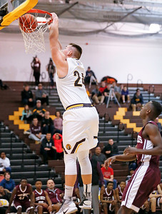 Cameron Krutwig (24) from Jacobs dunks the ball during the first quarter of their semifinal game against Zion-Benton during the Hinkle Holiday Classic boys basketball tournament at Jacobs High School on Monday, December 26, 2016 in Algonquin High School.  | John Konstantaras photo for the Northwest Herald