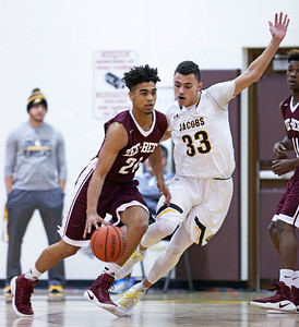 Nikolas Balkcom (33) from Jacobs defends and Jaalen Ray (24) from Zion-Benton drives during the first quarter of their semifinal game during the Hinkle Holiday Classic boys basketball tournament at Jacobs High School on Monday, December 26, 2016 in Algonquin High School.  | John Konstantaras photo for the Northwest Herald