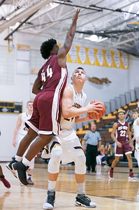 Cameron Krutwig (24) from Jacobs looks for a shot as he is fouled by DeAndre Green (44) from Zion-Benton during the second quarter of their semifinal game during the Hinkle Holiday Classic boys basketball tournament at Jacobs High School on Monday, December 26, 2016 in Algonquin High School.  | John Konstantaras photo for the Northwest Herald