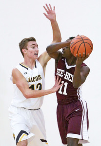 Cooper Schwartz (12) from Jacobs defends Damarquis Henry (11) from Zion-Benton during the second quarter of their semifinal game during the Hinkle Holiday Classic boys basketball tournament at Jacobs High School on Monday, December 26, 2016 in Algonquin High School.  | John Konstantaras photo for the Northwest Herald