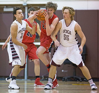 John Kerr (24) from Grant gras a rebound between James Queen (3) and Austen Ferbet (55) from Prairie Ridge during the first quarter of their semifinal game during the Hinkle Holiday Classic boys basketball tournament at Jacobs High School on Monday, December 26, 2016 in Algonquin High School. The Wolves defeated the Bulldogs 66-61.  | John Konstantaras photo for the Northwest Herald