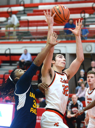 St. Charles East forward Justin Hardy grabs a rebound during the Saints game against Lincoln Park Dec. 27 at the Hinsdale Central Holiday Classic boys basketball tournament.<br /> Mark Busch - mbusch@shawmedia.com