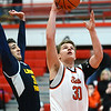 St. Charles East senior Jack Zylke goes to the basket during the Saints game against Lincoln Park Dec. 27 at the Hinsdale Central Holiday Classic boys basketball tournament.<br /> Mark Busch - mbusch@shawmedia.com