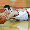 St. Charles East forward Justin Hardy dives for a loose ball during the Saints game against Lincoln Park Dec. 27 at the Hinsdale Central Holiday Classic boys basketball tournament.<br /> Mark Busch - mbusch@shawmedia.com