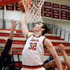 St. Charles East forward Justin Hardy scores on a putback during the Saints game against Lincoln Park Dec. 27 at the Hinsdale Central Holiday Classic boys basketball tournament.<br /> Mark Busch - mbusch@shawmedia.com