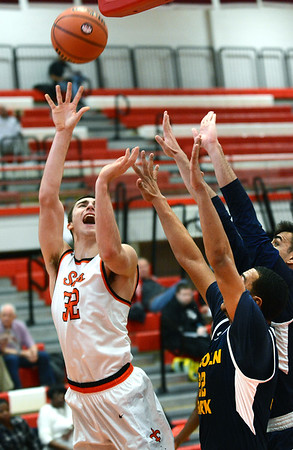 St. Charles East forward Justin Hardy is fouled while shooting during the Saints game against Lincoln Park Dec. 27 at the Hinsdale Central Holiday Classic boys basketball tournament.<br /> Mark Busch - mbusch@shawmedia.com