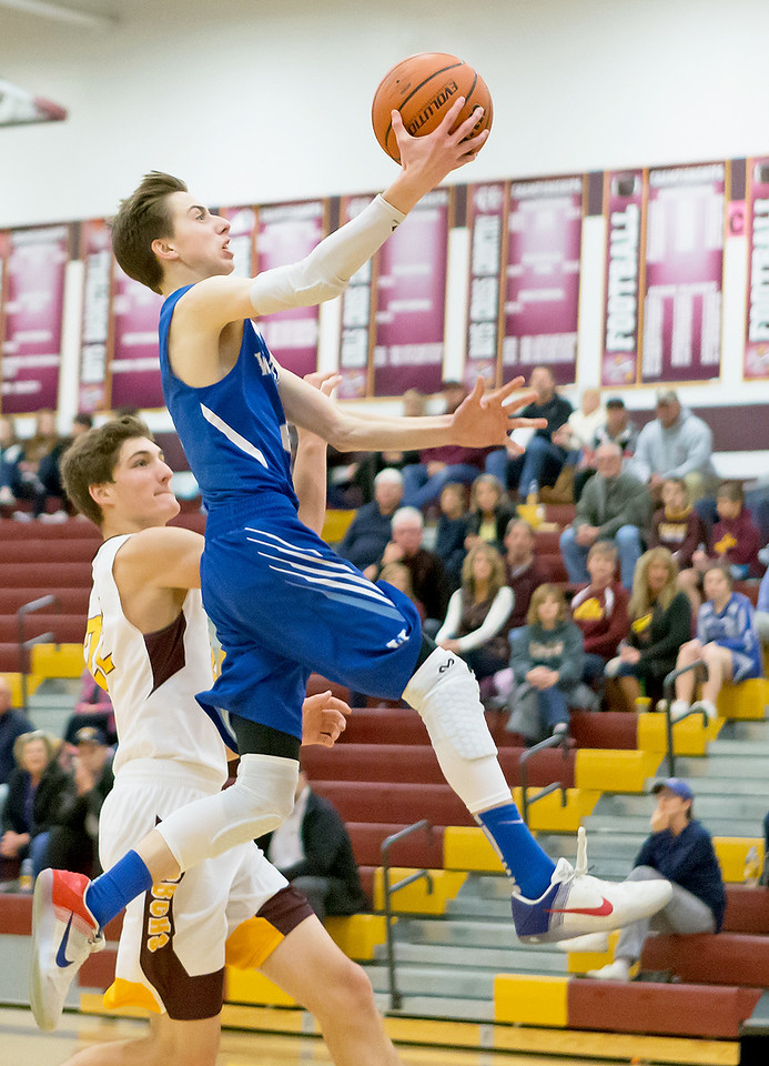 Woodstock's Tyler Peake goes in for the lay-up against Richmond-Burton Thursday, December 7, 2017 in Richmond. Richmond ended up with the 71-57 victory. KKoontz-For Shaw Media