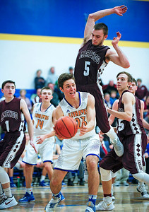 Brody Frazier (23) from Johnsburg passes the ball as Blaine Borhart (5) from Marengo defends during the fourth quarter of their game at Johnsburg High School on Friday, December 8, 2017 in Johnsburg, Illinois. John Konstantaras photo for Shaw Media