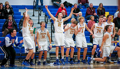 Johnsburg players celebrate on the bench during the final seconds of their win over Marengo at Johnsburg High School on Friday, December 8, 2017 in Johnsburg, Illinois. John Konstantaras photo for Shaw Media