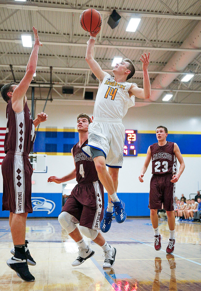 Zach Toussaint (14) from Johnsburg drives to the basket during the second quarter of their game against Marengo at Johnsburg High School on Friday, December 8, 2017 in Johnsburg, Illinois. John Konstantaras photo for Shaw Media