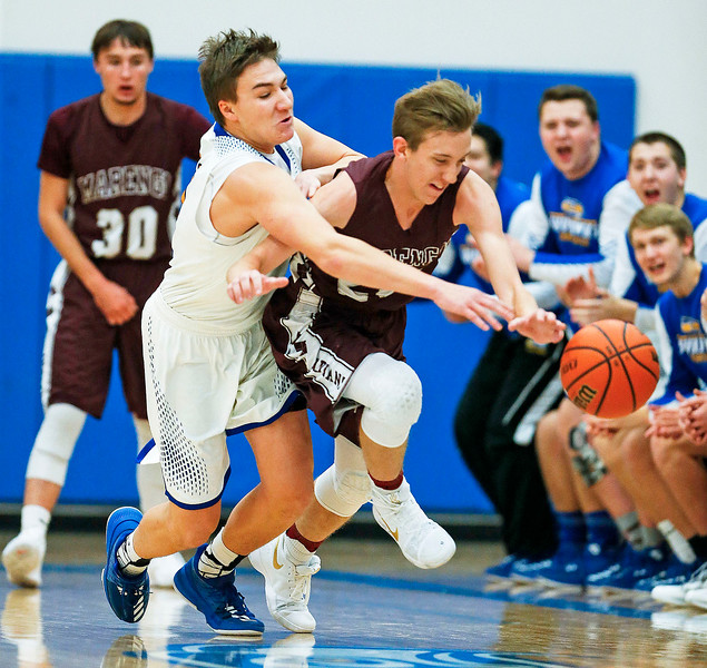 Mason Sobiesk (left) from Johnsburg and Aidan Kirchner (25) from Marengo battle for a loose ball during the first quarter of their game at Johnsburg High School on Friday, December 8, 2017 in Johnsburg, Illinois. John Konstantaras photo for Shaw Media