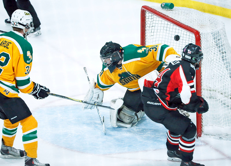 Brennan Kelly (right, 14) from D155 scores a goal past Garrett Braden (31) from Crystal Lake South during the first period of their game at the Leafs Ice Center on Sunday, December 10, 2017 in West Dundee, Illinois. The game ended in a 3-3 tie. John Konstantaras photo for Shaw Media