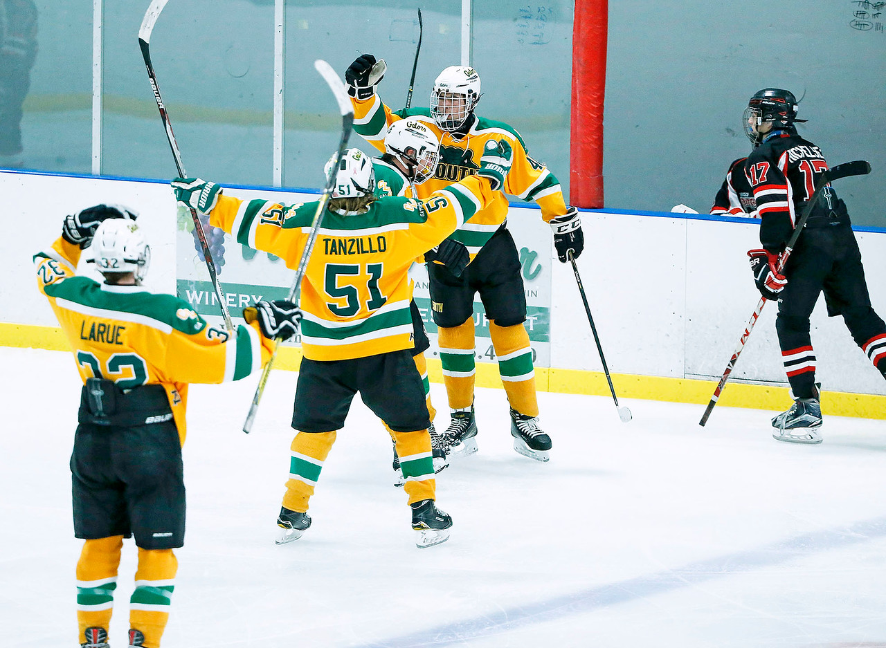Evan Jewson (40, right) from Crystal Lake South celebrates his goal with his teammates during the third period of their game against D155 at the Leafs Ice Center on Sunday, December 10, 2017 in West Dundee, Illinois. The game ended in a 3-3 tie. John Konstantaras photo for Shaw Media