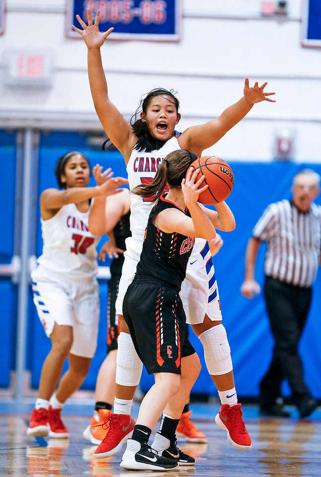 Gianine Boado (32) from Dundee-Crown pressures Elise Olson (5) from Crystal Lake Central during the first quarter of their game at Dundee-Crown High School  on Tuesday, December 12, 2017 in Carpentersville, Illinois. The Chargers defeated the Tigers 50-20. John Konstantaras photo for Shaw Media