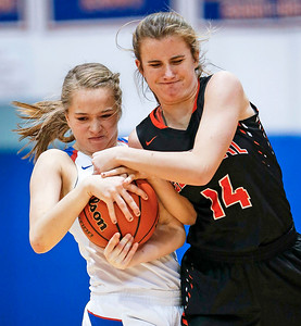 Kendall Kieltyka (23) from Dundee-Crown and Emma Fleming (14) from Crystal Lake Central battle for a ball during the fourth quarter of their game at Dundee-Crown High School  on Tuesday, December 12, 2017 in Carpentersville, Illinois. The Chargers defeated the Tigers 50-20. John Konstantaras photo for Shaw Media