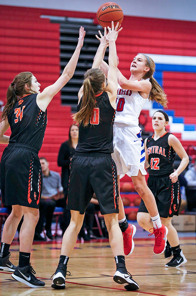 Katelyn Skibinski (10) from Dundee-Crown drives to the basket over Tara Ernd (31) and Madelyn Hollander (10) from Crystal Lake Central during the fourth quarter of their game at Dundee-Crown High School  on Tuesday, December 12, 2017 in Carpentersville, Illinois. The Chargers defeated the Tigers 50-20. John Konstantaras photo for Shaw Media