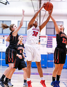 Alyssa Crenshaw (30) from Dundee-Crown grabs a rebound between Tara Ernd (left) and Megan Wozniak (23) from Crystal Lake Central during the first quarter of their game at Dundee-Crown High School  on Tuesday, December 12, 2017 in Carpentersville, Illinois. The Chargers defeated the Tigers 50-20. John Konstantaras photo for Shaw Media