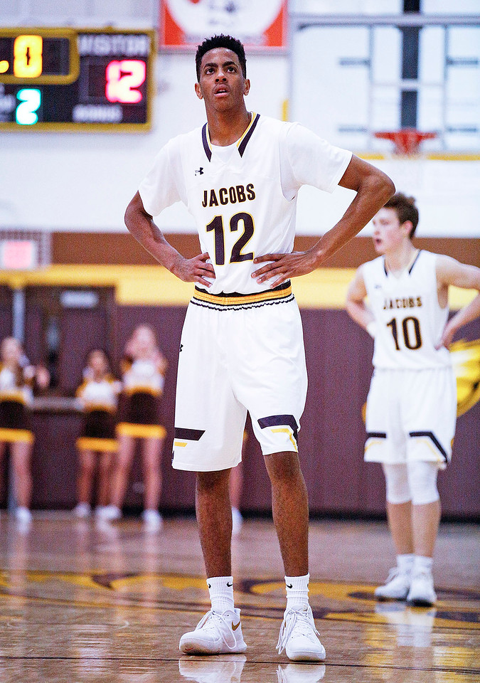 Kameron Mack (12) from Jacobs waits to shoot a free throw during the second quarter of their game against Huntley at Jacobs High School  on Wednesday, December 13, 2017 in Algonguin, Illinois. The Golden Eagles defeated the Red Raiders 58-37. John Konstantaras photo for Shaw Media