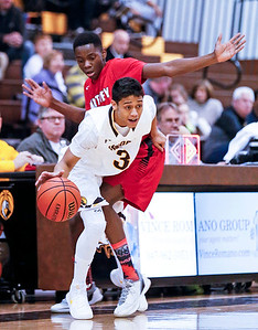 Ajani Rodriguez (3) from Jacobs is fouled by Uchenna Egekeze (32) from Huntley during the first quarter of their game at Jacobs High School  on Wednesday, December 13, 2017 in Algonguin, Illinois. The Golden Eagles defeated the Red Raiders 58-37. John Konstantaras photo for Shaw Media