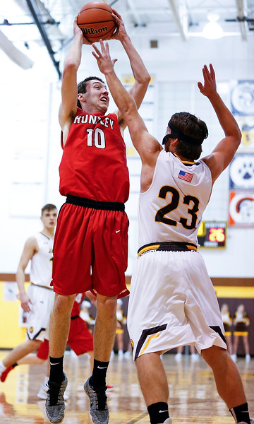 Brett Bigden (10) from Huntley shoots over Daniel Murray (23) from Jacobs during the fourth quarter of their game at Jacobs High School  on Wednesday, December 13, 2017 in Algonguin, Illinois. The Golden Eagles defeated the Red Raiders 58-37. John Konstantaras photo for Shaw Media
