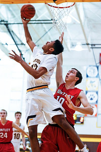 Kameron Mack (12) from Jacobs scores a basket as \h10 defends during the first quarter of their game at Jacobs High School  on Wednesday, December 13, 2017 in Algonguin, Illinois. The Golden Eagles defeated the Red Raiders 58-37. John Konstantaras photo for Shaw Media