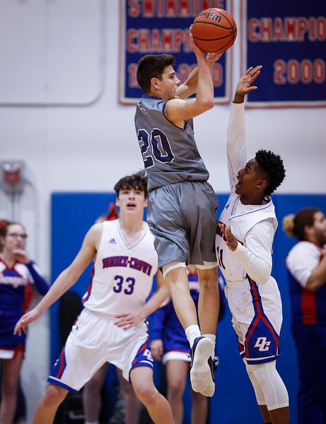Beaumont Frericks (20) from Cary-Grove passes over Trayvon Hatcher (11) from Dundee-Crown during the third quarter of their game at Dundee-Crown on Friday, December 15, 2017 in Carpentersville, Illinois. The Chargers defeated the Trojans 70-51. John Konstantaras photo for Shaw Media