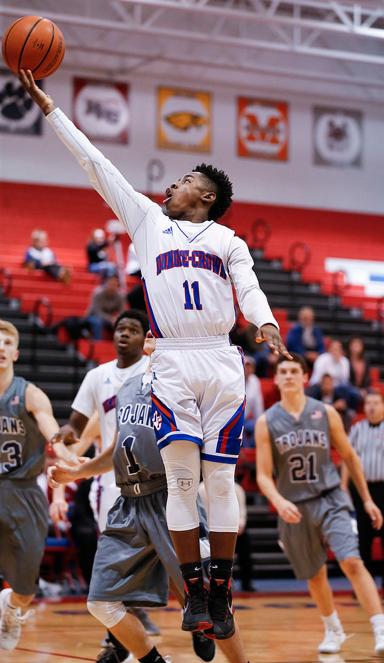 Trayvon Hatcher (11) from Dundee-Crown scores on a layup during the fourth quarter of their game against Cary-Grove at Dundee-Crown on Friday, December 15, 2017 in Carpentersville, Illinois. The Chargers defeated the Trojans 70-51. John Konstantaras photo for Shaw Media